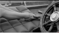 Angela caressing the foot of a the young sailor.